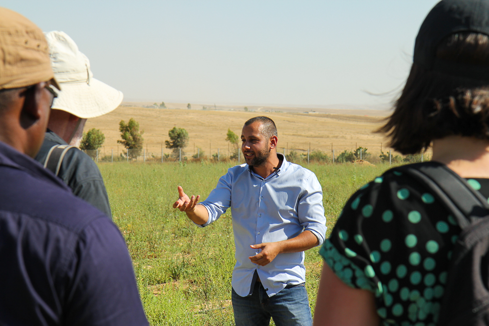 Amran Amarni, 2018 fellow and Director of the Visitor's Center at Project Wadi Attir, gives tour to GSF fellows