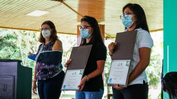 Francely Concepción Flores and Juana Suar Domínguez, 2020 Sustainability Prizewinners, holding their certificates on stage with Irene Alvarado at EARTH University