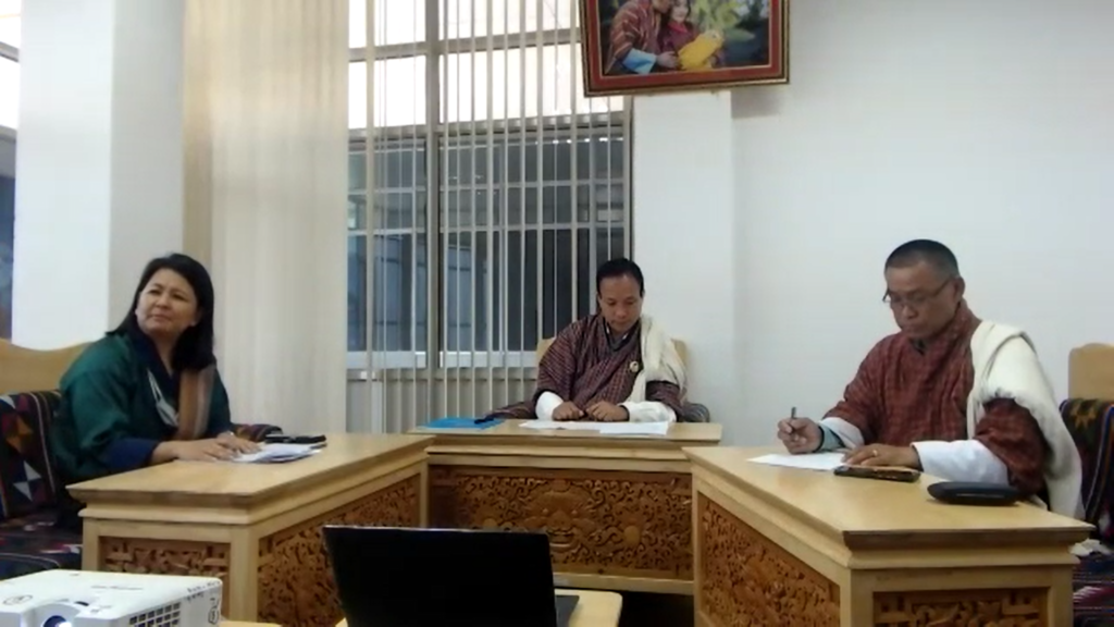 From left: Tshering Choden, Chief, External Relations Division, Office of the Vice Chancellor of the Royal University of Bhutan; Dasho Nidup Dorji, Vice Chancellor of the Royal University of Bhutan; and Dr. Phanchung, Director, Research and External Relations, sitting at table during the virtual signing ceremony.